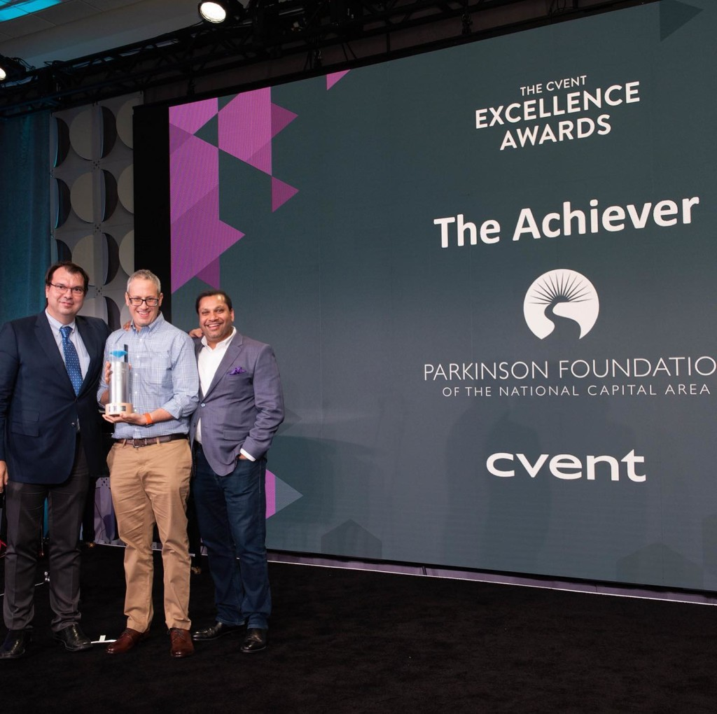 PFNCA President & CEO Jared Cohen (center) accepts award from CVENT CEO & Founder Reggie Arggarwal (left). They are joined by PFNCA Medical Advisory Board Member Dr. Zoltan Mari